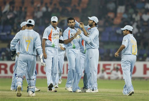 India players celebrate with Zaheer Khan after he dismissed Tillakaratne Dilshan during the third ODI match of the five match series in Colombo on Tuesday. (AP Photo)