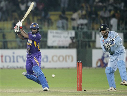Kumar Sangakkara plays a shot as Mahendra Singh Dhoni takes his position during the third ODI match of the five match series in Colombo on Tuesday. (AP Photo)