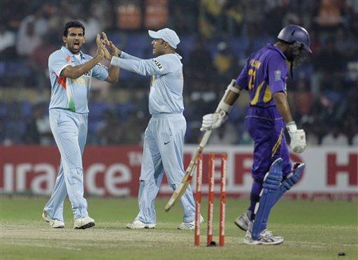 Zaheer Khan celebrates the dismissal of Tillakaratne Dilshan with team-mate Virender Sehwag during the third ODI match of the five match series in Colombo on Tuesday. (AP Photo)