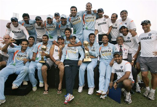 Indian team members pose for photographs after their 4-1 series win against Sri Lanka in Colombo on Sunday. (AP Photo)