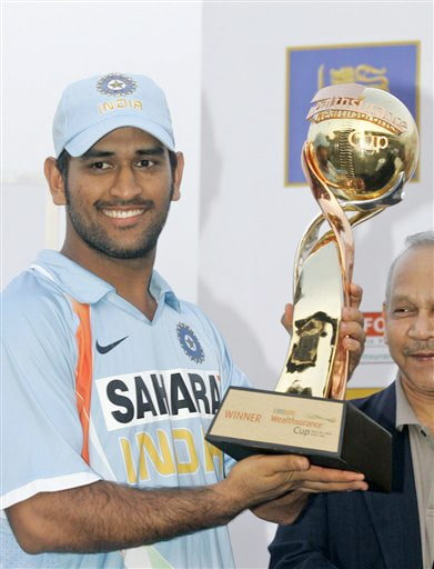 Mahendra Singh Dhoni holds the trophy after India beat Sri Lanka 4-1 in the five match ODI series in Colombo on Sunday. (AP Photo)
