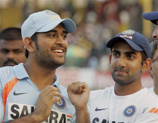 Mahendra Singh Dhoni and Gautam Gambhir share a light moment at the end of the final ODI match between India and Sri Lanka in Colombo on Sunday. (AP Photo)