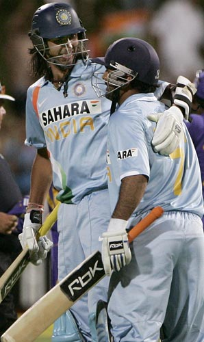 But MS Dhoni on the other hand, carried on strongly. With three to get from the final over, he hit the winning runs through cover. Here, he celebrates with Ishant Sharma after the win.