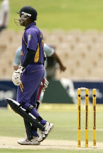 Sanath Jayasuriya is disappointed after being run out in an unfortunate manner, with the ball deflecting off Munaf Patel's hands on to the stumps.