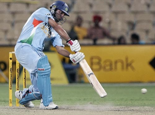 With three wickets gone, Yuvraj Singh starts India's rearguard action, pulling and driving to good effect. Here, he cover drives one to the boundary.