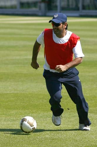 MS Dhoni kicks a soccer ball during a net practice at Lord's cricket ground, London, on May 31, 2009. India will play a Twenty20 warm up match against New Zealand ahead of Twenty20 World Cup which starts at Lord's on June 5, 2009. (AP Photo)