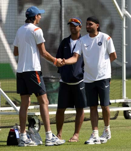 Harbhajan Singh shakes hands with Ishant Sharma during a net practice at Lord's cricket ground, London. (AP Photo)