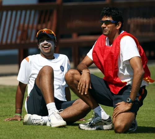 Pragyan Ojha and bowling coach Venkatesh Prasad laugh during a game of football during a net practice at Lord's cricket ground, London. (AP Photo)