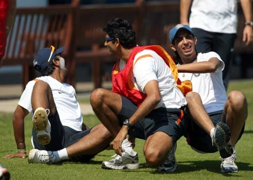 Pragyan Ojha, India's bowling coach Venkatesh Prasad and Ishant Sharma laugh during a game of football during a net practice at Lord's cricket ground, London. (AP Photo)