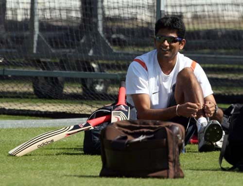 Venkatesh Prasad puts his shoes on during a net practice at Lord's cricket ground, London. (AP Photo)