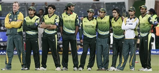Pakistani cricket players react after India's Robin Uthapa's delivery hits the stumps during their Twenty20 World Championship.