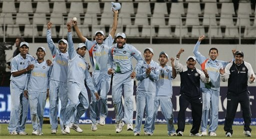 Indian cricket players celebrate after Robin Uthapa's delivery hits the stumps.