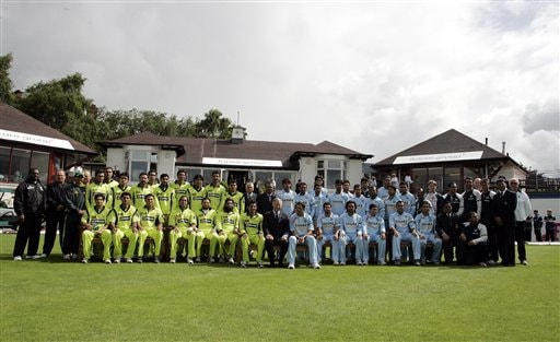Britain's Prince Charles, The Prince of Wales, center, with the Pakistan team left and Indian team right ahead of their Future Friendship Cup One day international cricket match at Citylets Titwood cricket ground,Glasgow, Scotland, Tuesday, July 3, 2007.