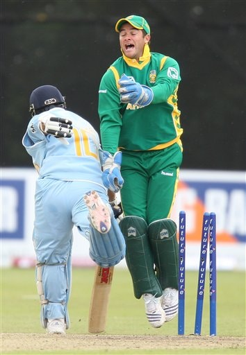 Sachin Tendulkar, left, is run out on 99 runs by South Africa Wicket keeper Mark Boucher during the One Day International series match at Stormont, Belfast, Northern Ireland, Tuesday, June 26, 2007.