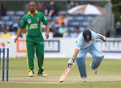 Sachin Tendulkar, right, survives a run out attempt , as South Africa's Thandi Tshabalala looks on during the One Day International series match against South Africa, in Stormont, Belfast, Northern Ireland, Tuesday, June 26, 2007.