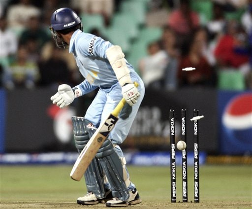 Dinesh Karthik is bowled by Pakistan's Muhammad Asif during their Twenty20 World Championship Cricket in Durban, South Africa, Friday, Sept. 14, 2007.