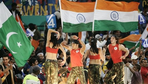 Dancers perform before fans raising India and Pakistan's national flags during their Twenty20 World Championship Cricket in Durban, South Africa, Friday, Sept. 14, 2007.