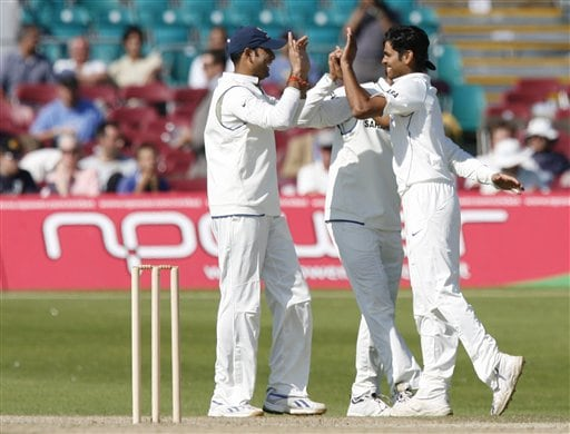 RP Singh, right, is congratulated by team mates after claiming the wicket of Sussex batsman Carl Hopkinson during their cricket match, Hove, Britain, Sunday July 8, 2007. India will face England in the first test at Lords Thursday July 19, 2007.