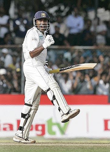 Sri Lanka captain Mahela Jayawardene celebrates after hitting the winning runs against India.