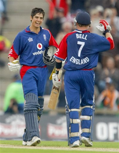 England's Alastair Cook, left, celebrates after making his maiden one-day cricket century with his teammate Ian Bell who also went on to make his own maiden one-day cricket century during the one-day cricket match between England and India at The Rose Bowl cricket ground in Southampton, England, Tuesday, Aug. 21, 2007.