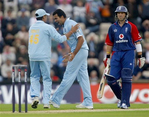 Zaheer Khan, center, celebrates with Rohit Sharma, left, after taking the wicket of England's Matthew Prior, right, during the one-day cricket match between England and India at The Rose Bowl cricket ground in Southampton, England, Tuesday, Aug. 21, 2007.
