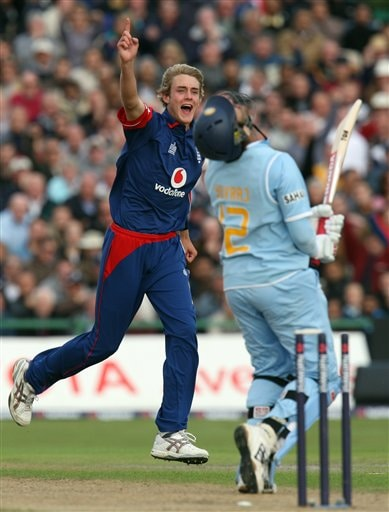England's Stuart Broad, left, celebrates after taking the wicket of India's Yuvraj Singh, right, for 71 during their fourth One Day International cricket match in Manchester, England, Thursday Aug. 30, 2007.