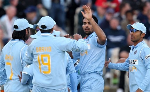 Zaheer Khan, second right, celebrates with teammates after bowling England's Alistair Cook for 0 during their fourth One Day International cricket match in Manchester, England, Thursday Aug. 30, 2007.