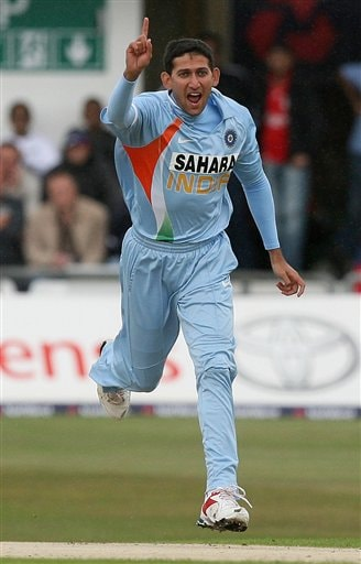 Ajit Agarkar celebrates taking the wicket of England's Alastair Cook during the fifth one day International match at Headingley Cricket ground in Leeds, England, Sunday Sept. 2, 2007.