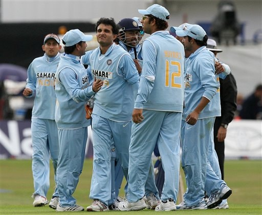 England's Matt Prior, right, looks at his wicket after being stumped by India's Mahendra Dhoni, centre, off the bowling of Sourav Ganguly, left, during the fifth one day International match at Headingley Cricket ground in Leeds, England, Sunday Sept. 2, 2007.