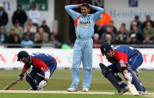 Ajit Agarkar, centre, holds his head as England's Matt Prior, left, and Ian Bell, right, score runs during the fifth one day International match Headingley Cricket ground in Leeds, England, Sunday Sept. 2, 2007.
