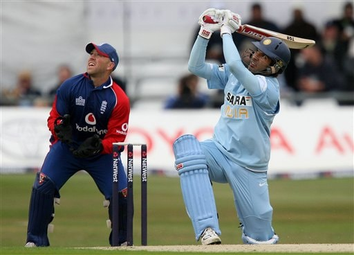 Yuvraj Singh, right, hits the ball for six to bring up his fifty against England during the fifth one day International match Headingley Cricket ground in Leeds, England, Sunday Sept. 2, 2007.