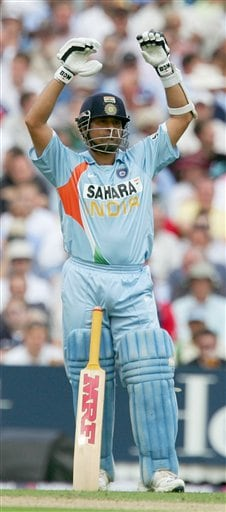 Sachin Tendulkar signals to the dressing room for assistance during the sixth one day international cricket match against England at the Oval, London, Wednesday, Sept. 5, 2007.