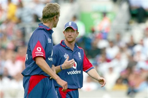 After being hit for a six by India's Sourav Ganguly, England's Stuart Broad, left, is given some guidance by Paul Collingwood during the sixth one day international cricket match at the Oval, London, Wednesday Sept. 5, 2007.