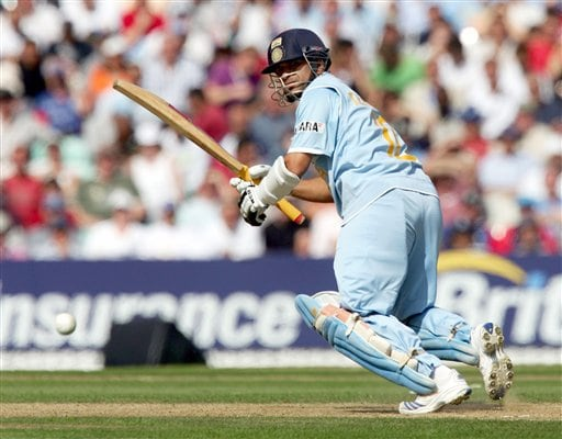 Sachin Tendulkar hits a ball from England's James Anderson during the sixth one day international cricket match at the Oval, London, Wednesday Sept. 5, 2007.