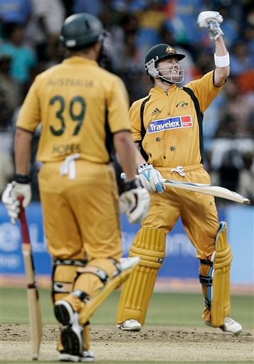 Australia's Michael Clarke, right, celebrates his century against India during their first One-Day international cricket match in Bangalore, India, Saturday, Sept. 29, 2007.