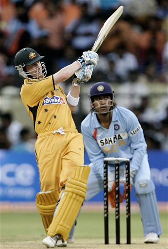 Australia's Brad Haddin, left, plays a shot as India's wicket keeper Mahendra Singh Dhoni looks on, during the first One-Day international cricket match between the two teams in Bangalore, India, Saturday, Sept. 29, 2007.