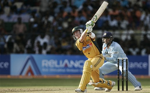 Australian cricketer Brad Haddin plays a shot, as India's wicket keeper Mahendra Singh Dhoni looks on during the first One-Day international cricket match between the two teams in Bangalore, India, Saturday, Sept. 29, 2007.