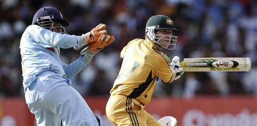Australian cricketer Brad Haddin, right, plays a shot, as Indias Mahendra Dhoni looks on during the first One-Day international cricket match between the two teams in Bangalore, India, Saturday, Sept. 29, 2007.
