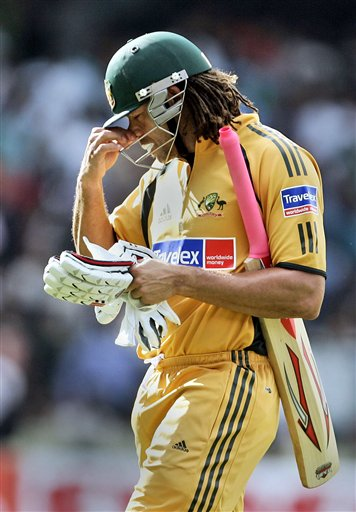 Australian cricketer Andrew Symonds gestures while leaving the ground after his dismissal by India's S.Sreesanth during the first One-Day international cricket match between the two teams in Bangalore, India, Saturday, Sept. 29, 2007.