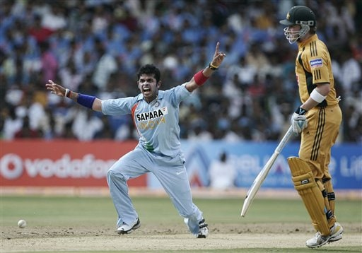 Sreesanth, left, appeals successfully for the dismissal of Australia's Andrew Symonds during the first One-Day international cricket match between the two teams in Bangalore, India, Saturday, Sept. 29, 2007.