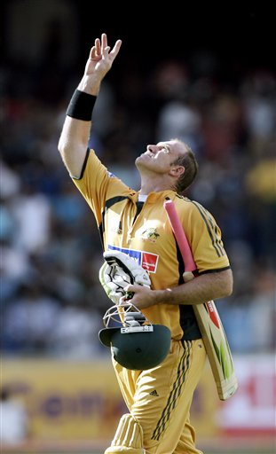Australia's Mathew Hayden looks up towards the sky while leaving the ground after his dismissal by India's S.Sreesanth during their first one day international cricket match in Bangalore, India Saturday Sept. 29, 2007.