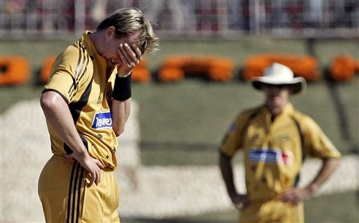 Australia's Brett Lee, left, reacts after an unsuccessful appeal for the dismissal of India's Sachin Tendulkar during the fourth one day international cricket match in Chandigarh, India Monday Oct 8, 2007.