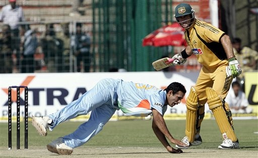 Irfan Pathan, left, dives to stop the ball as Australia's Matthew Hayden, looks on during the fourth one day international cricket match in Chandigarh, India, Monday, Oct. 8, 2007.