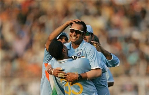 Murali Kartik, center facing camera, celebrates with teammates after successfully dismissing Australia's Brett Lee during the seventh one-day international cricket match against Australia in Mumbai, India, Wednesday, Oct. 17, 2007.
