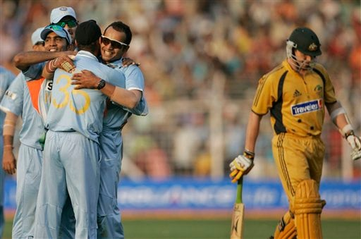 Murali Kartik, center facing camera, celebrates with teammates after successfully dismissing Australia's Brett Lee, right, during the seventh one-day international cricket match against Australia in Mumbai, India, Wednesday, Oct. 17, 2007