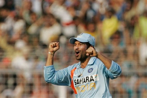 Sachin Tendulkar reacts after taking the catch to dismiss Australia's Andrew Symonds during the seventh One-Day international cricket match in Mumbai, India, Wednesday, Oct. 17, 2007.