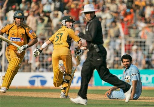 Zaheer Khan, right, looks on as Australia's Ricky Ponting, left, and Brad Haddin, second left, run between the wickets during the seventh One-Day international cricket match in Mumbai, India, Wednesday, Oct. 17, 2007.