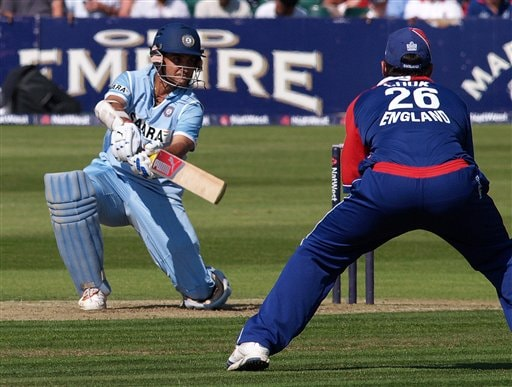India's Sourav Ganguly, left, gets the ball past England's Alastair Cook during the 2nd one-day cricket match series between England, and India, in Bristol, England on Friday.