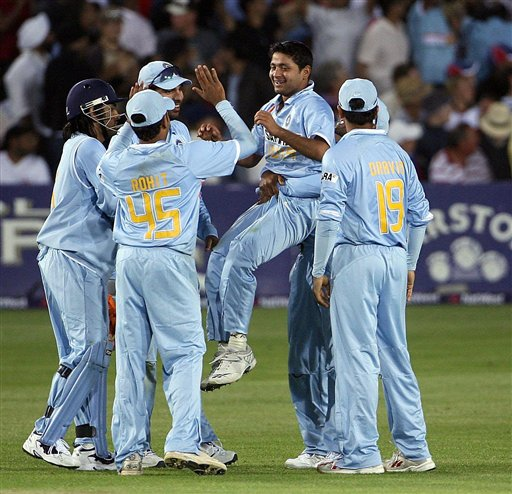 India's Piyush Chawla, center, celebrates after bowling out Kevin Pietersen for 25 at the County Ground, Bristol, England on Friday.