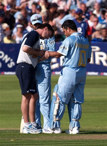 A physio looks at the wrist and forearm of India's Sachin Tendulkar, right, during his innings in the 2nd one-day cricket match series between England and India, in Bristol, England on Friday.